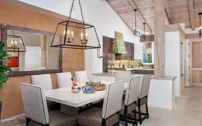 Luxury 8 person dining table with kitchen in the background