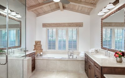 Master bath with large soaking tub and glass shower stall