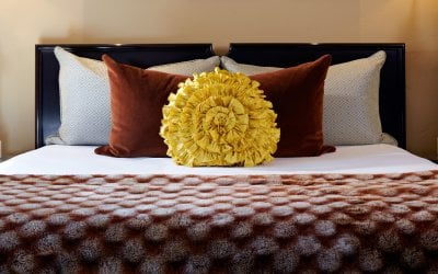 Master bedroom with yellow round pillow