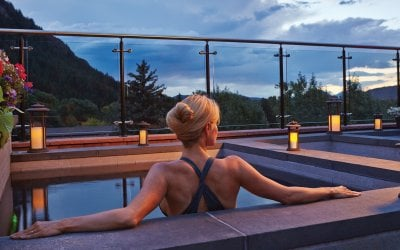 A women relaxing on rooftop hot tub