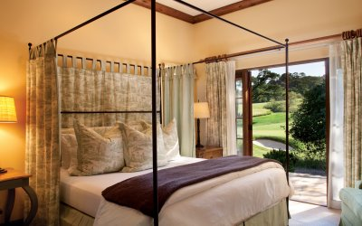 Casita bedroom with canopy bed and opened patio doors