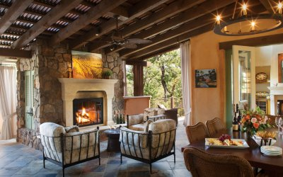 Open villa terrace with fireplace