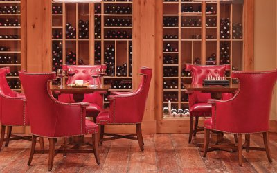 Wine room with red leather chairs