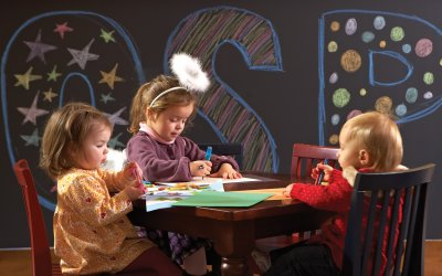 Tykes room with 3 toddlers coloring