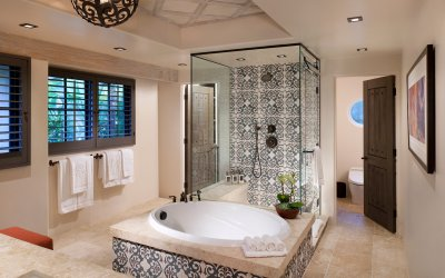 Hotel suite bathroom with large bath tub and shower stall