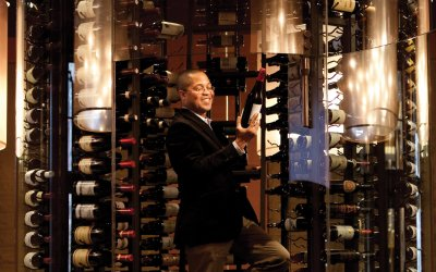 Tower of wine bottles with Sommelier