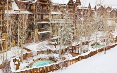 Exterior shot of slopeside hot tubs and residences.