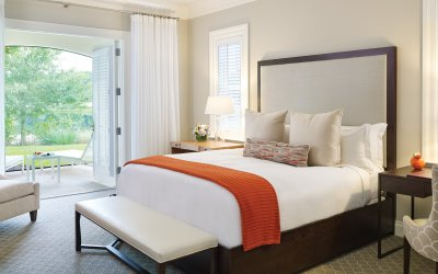 Residence bedroom with orange throw on bed