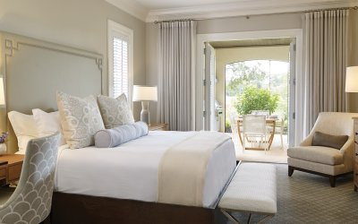Residence bedroom with neutral throw on bed